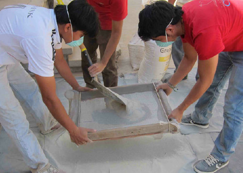 University students sifting clay in preparation for filter making - Ceramic Water Filter Solutions