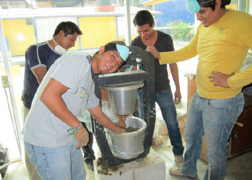 Forming the filters with the Potters for Peace portable press - Ceramic Water Filter Solutions