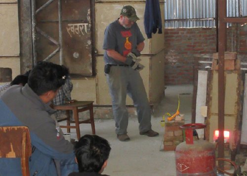 Firing filters in the test kiln with propane - Ceramic Water Filter Solutions